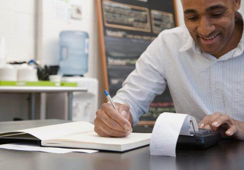 Businessman working on notebook
