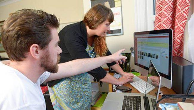Web designer helping a client